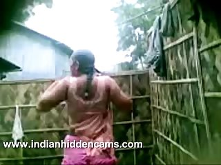 indian girl from village taking open air shower recorded by neighbour on mobile